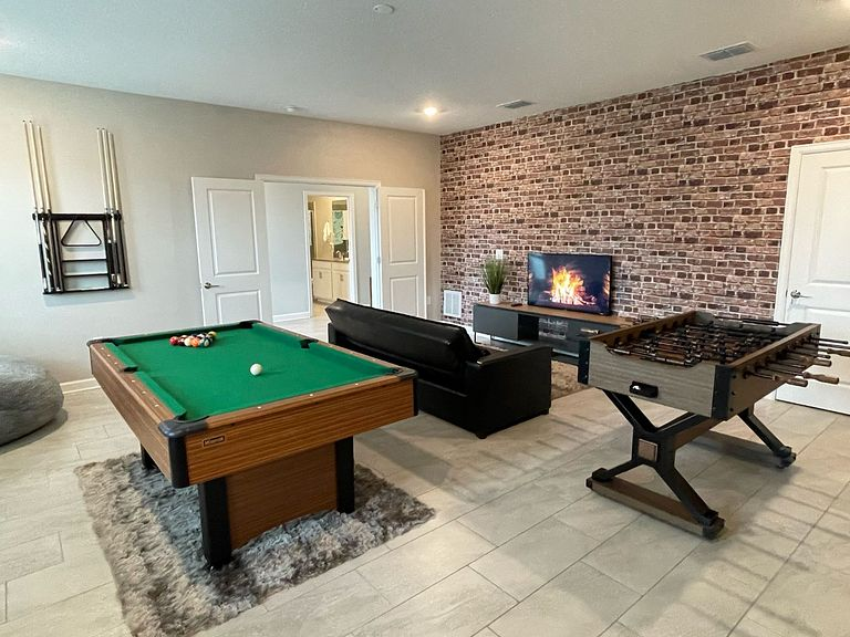 Home in Champions Gate Oasis Golf community, with FREE grill